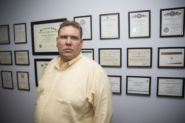 Insurance broker Eliam Marrero in his Las Vegas office on Tuesday, Nov. 15, 2016, in Las Vegas. Marrero said he does not take new clients searching for health insurance through the Obamacare excha ...