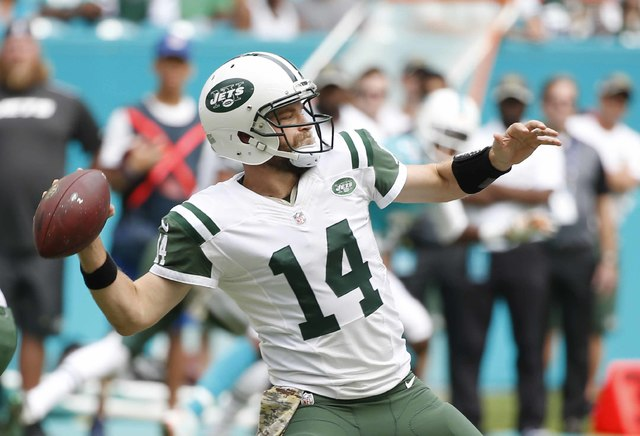 New York Jets quarterback Ryan Fitzpatrick (14) looks to pass during the first half of an NFL football game against the Miami Dolphins on Nov. 6 in Miami Gardens, Fla. (Wilfredo Lee/AP)
