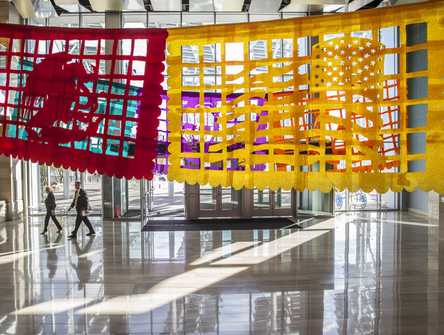 """Justin Favela's """"Patrimonio,"""" on display at Las Vegas City Hall through Dec. 15, uses traditional Mexican papel picado techniques to create new banners. Benjamin Hager/Las Vegas Review-Journal"""