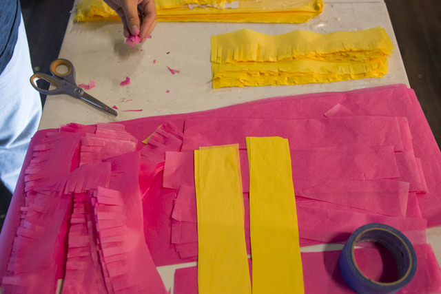 Artist Justin Favela hand-cuts strips of tissue paper to use on artworks that reflect and comment on his Latino heritage. Richard Brian/Las Vegas Review-Journal Follow @vegasphotograph