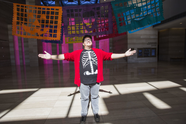 "Artist Justin Favela poses with his papel picado exhibit ""Patrimonio,"" on display at Las Vegas City Hall through Dec. 15. Richard Brian/Las Vegas Review-Journal Follow @vegasphotograph"