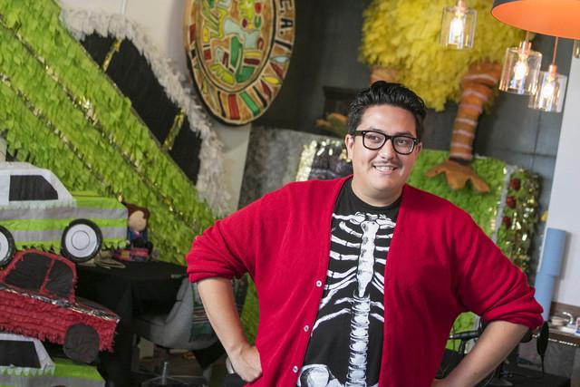 Artist in residence Justin Favela poses at his studio at downtown's Juhl condominium complex. Richard Brian/Las Vegas Review-Journal Follow @vegasphotograph