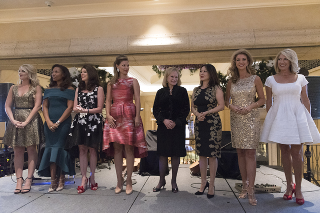 Kady Casullo, Southern Nevada's Make-A-Wish Volunteer of the Year, left, along with seven other women, is honored at the Vegas Gives event at the Grand Canal Shoppes in Las Vegas, Tuesday, Nov. 15 ...