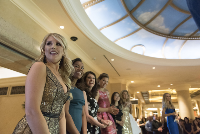 Kady Casullo, Southern Nevada's Make-A-Wish Volunteer of the Year, left, is honored at the Vegas Gives event at the Grand Canal Shoppes in Las Vegas, Tuesday, Nov. 15, 2016. Jason Ogulnik/Las Vega ...