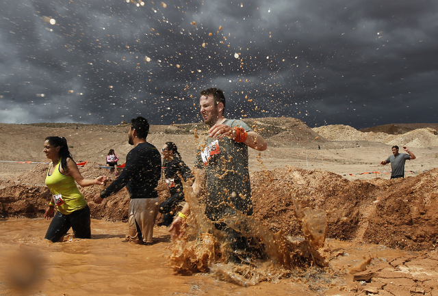 "Participants make their way through the ""mud mile"" obstacle during the Tough Mudder event out at Lake Las Vegas on Saturday, April 26, 2014. (Jason Bean/Las Vegas Review-Journal)"
