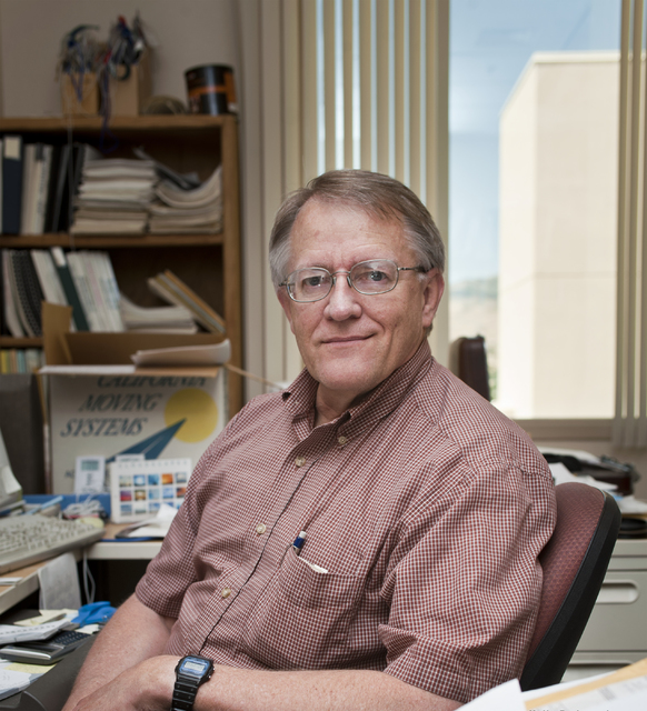 Climatologist Kelly Redmond poses in his Western Regional Climate Center office at the Desert Research Institute in Reno. Redmond died Thursday at age 64. (Desert Research Institute)