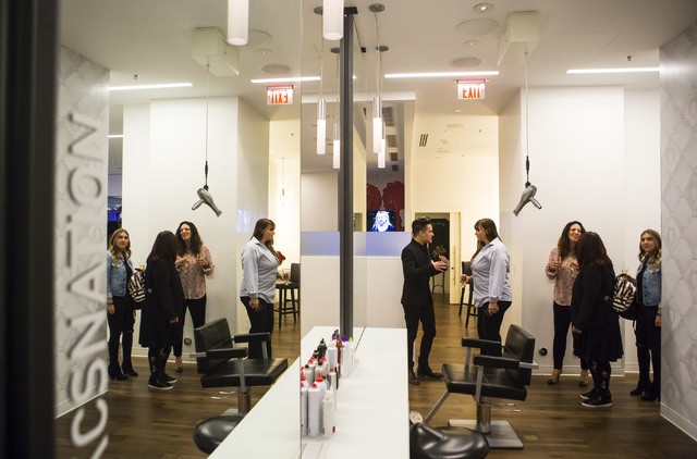 Salon Director Bobby Bosch, center, gives a tour to invited guests during the grand opening of Kelly Cardenas Salon at the Hard Rock hotel-casino in Las Vegas on Wednesday, Nov. 16, 2016. Chase St ...