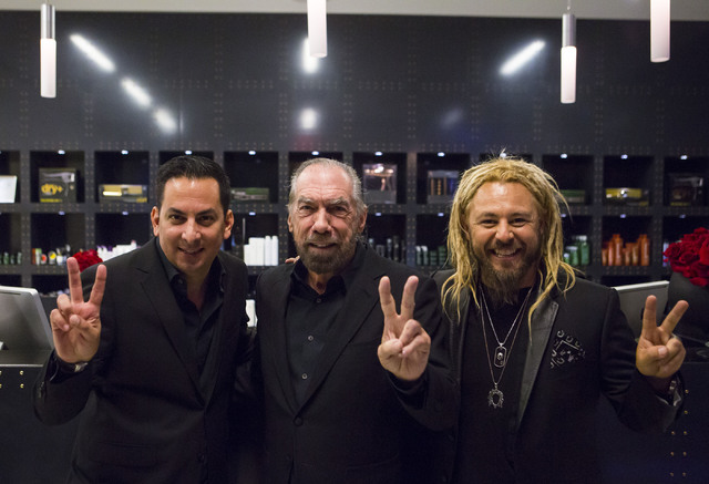 Marc Jay, from left, John Paul DeJoria, and Kelly Cardenas pose for a photo during the grand opening of Kelly Cardenas Salon at the Hard Rock hotel-casino in Las Vegas on Wednesday, Nov. 16, 2016. ...