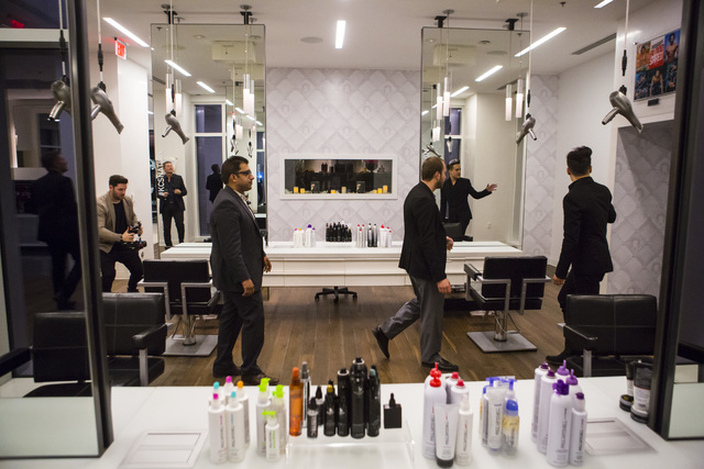 Salon Director Bobby Bosch, far right, gives a tour to invited guests during the grand opening of Kelly Cardenas Salon at the Hard Rock hotel-casino in Las Vegas on Wednesday, Nov. 16, 2016. Chase ...