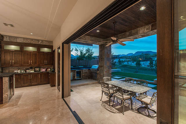 The kitchen opens to an outdoor kitchen on the patio. (Courtesy )