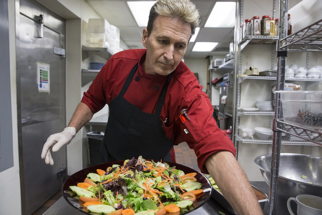 Cook Tim Walsh prepares a salad at KIT's Kitchen on Thursday, Nov. 17, 2016, in Henderson. (Benjamin Hager/Las Vegas Review-Journal)