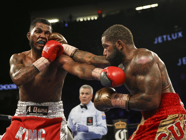 Curtis Stevens, right, hits James De La Rosa during their middleweight boxing matchat T-Mobile Arena in Las Vegas on Saturday, Nov. 19, 2016. Chase Stevens/Las Vegas Review-Journal Follow @cssteve ...