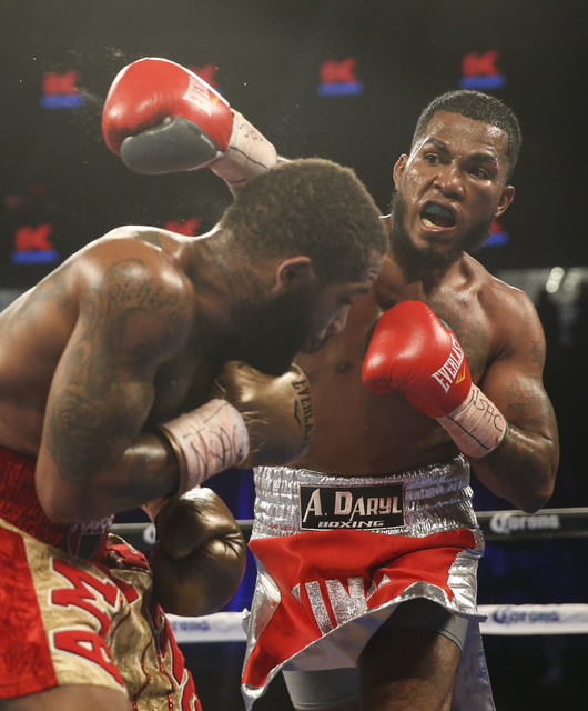 Curtis Stevens, left, is hit by James De La Rosa during their middleweight boxing matchat T-Mobile Arena in Las Vegas on Saturday, Nov. 19, 2016. Chase Stevens/Las Vegas Review-Journal Follow @css ...