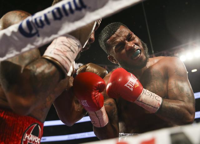 Curtis Stevens, left, hits James De La Rosa during their middleweight boxing matchat T-Mobile Arena in Las Vegas on Saturday, Nov. 19, 2016. Chase Stevens/Las Vegas Review-Journal Follow @cssteven ...