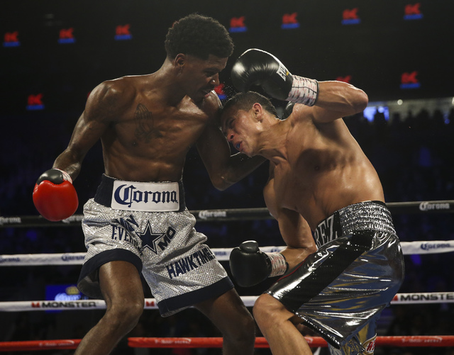 Maurice Hooker, left, and Darleys Perez trade punches during their junior welterweight boxing match at T-Mobile Arena in Las Vegas on Saturday, Nov. 19, 2016. Chase Stevens/Las Vegas Review-Journa ...