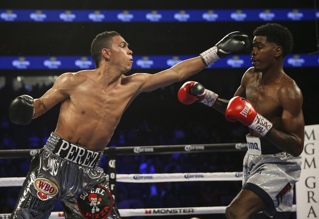Darleys Perez, left, hits Maurice Hooker during their junior welterweight boxing match at T-Mobile Arena in Las Vegas on Saturday, Nov. 19, 2016. Chase Stevens/Las Vegas Review-Journal Follow @css ...