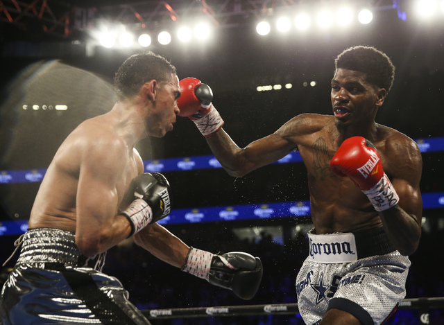 Maurice Hooker, right, hits Darleys Perez during their junior welterweight boxing match at T-Mobile Arena in Las Vegas on Saturday, Nov. 19, 2016. Chase Stevens/Las Vegas Review-Journal Follow @cs ...