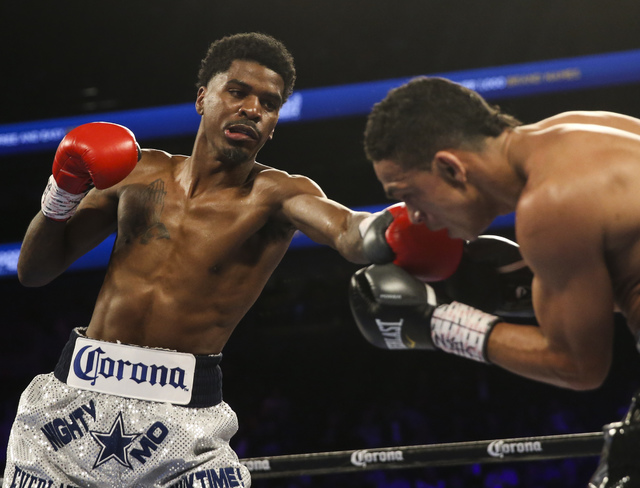 Maurice Hooker, left, hits Darleys Perez during their junior welterweight boxing match at T-Mobile Arena in Las Vegas on Saturday, Nov. 19, 2016. Chase Stevens/Las Vegas Review-Journal Follow @css ...