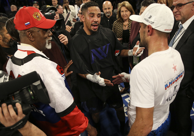 Andre Ward, center, greets Sergey Kovalev after Ward won in a unanimous decision in their light heavyweight title boxing match at T-Mobile Arena in Las Vegas on Saturday, Nov. 19, 2016. Chase Stev ...