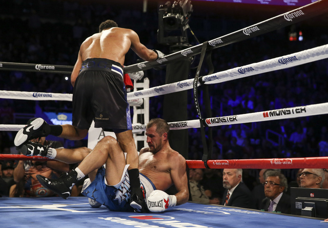 Sergey Kovalev, right, is tripped up by Andre Ward during their light heavyweight title boxing match at T-Mobile Arena in Las Vegas on Saturday, Nov. 19, 2016. Ward won in a unanimous decision. Ch ...