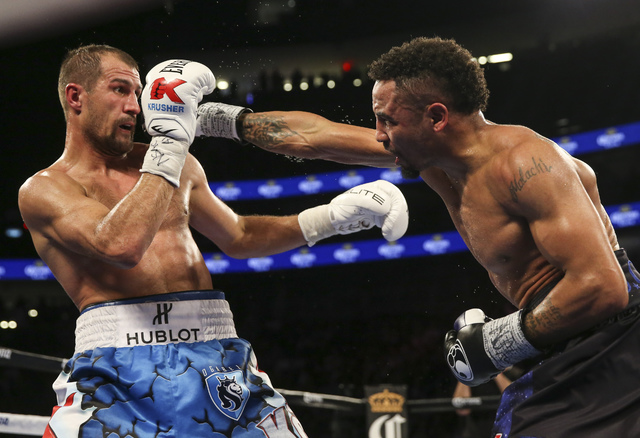 Andre Ward, right, hits Sergey Kovalev during their light heavyweight title boxing match at T-Mobile Arena in Las Vegas on Saturday, Nov. 19, 2016. Ward won in a unanimous decision. Chase Stevens/ ...