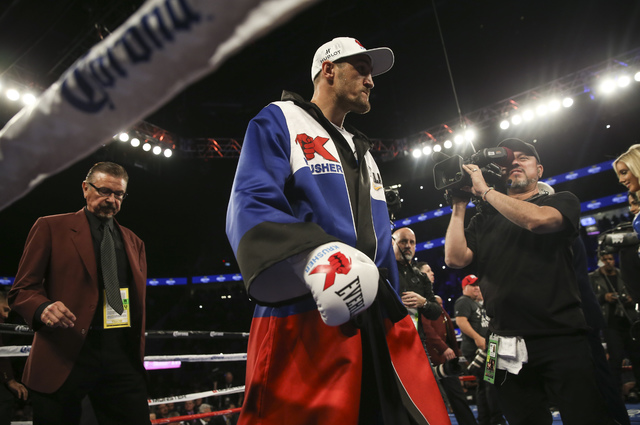 Sergey Kovalev enters the ring before fighting Andre Ward in their light heavyweight title boxing match at T-Mobile Arena in Las Vegas on Saturday, Nov. 19, 2016. Ward won in a unanimous decision. ...
