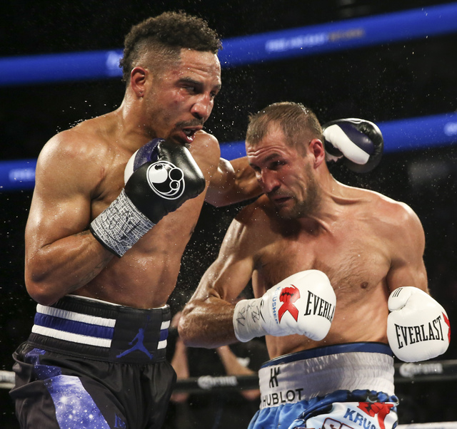 Andre Ward, left, and Sergey Kovalev trade punches during their light heavyweight title boxing match at T-Mobile Arena in Las Vegas on Saturday, Nov. 19, 2016. Ward won in a unanimous decision. Ch ...