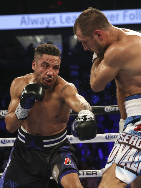 Andre Ward, left, hits Sergey Kovalev during their light heavyweight title boxing match  at T-Mobile Arena in Las Vegas on Saturday, Nov. 19, 2016. Ward won in a unanimous decision. Chase Stevens/ ...