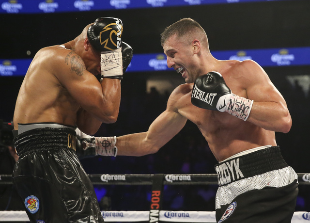 Oleksandr Gvozdyk, right, hits Isaac Chilemba during their light heavyweight boxing match at T-Mobile Arena in Las Vegas on Saturday, Nov. 19, 2016. Chase Stevens/Las Vegas Review-Journal Follow @ ...