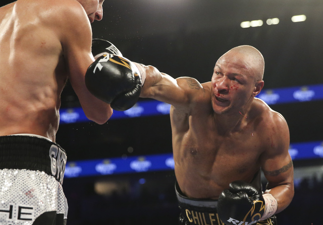 Oleksandr Gvozdyk, left, takes a hit from Isaac Chilemba during their light heavyweight boxing match at T-Mobile Arena in Las Vegas on Saturday, Nov. 19, 2016. Chase Stevens/Las Vegas Review-Journ ...
