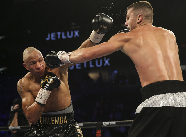 Oleksandr Gvozdyk hits Isaac Chilemba during their light heavyweight boxing match at T-Mobile Arena in Las Vegas on Saturday, Nov. 19, 2016. Chase Stevens/Las Vegas Review-Journal Follow @cssteven ...
