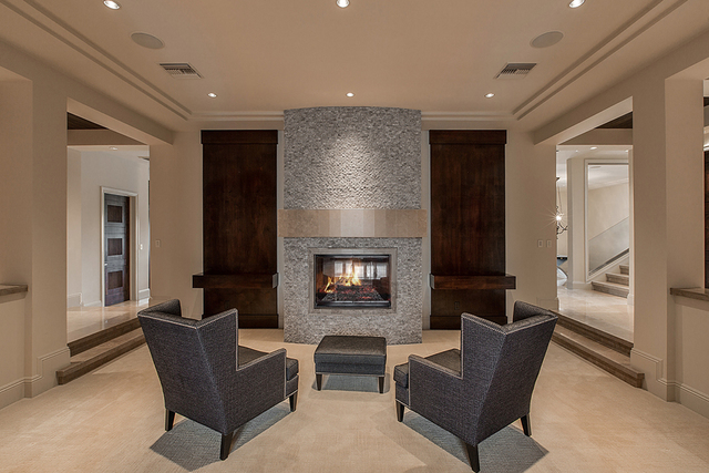 The living room has a dramatic fireplace. (Courtesy)