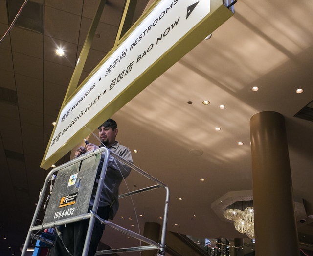 Eli Esponoca welds a wire on sign written in English and Chinese languages at the Lucky Dragon hotel-casino, 300 W. Sahara Ave., on Friday, Nov. 18, 2016. Las Vegas' newest casino, which will cate ...
