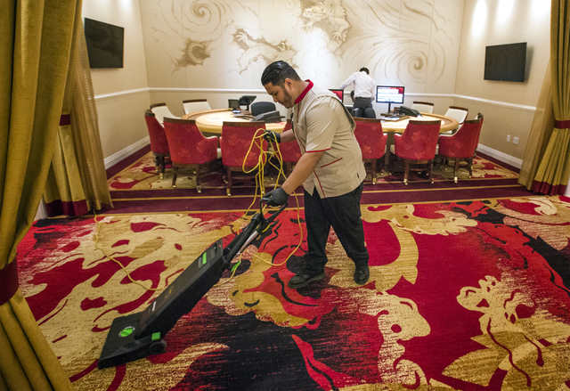 Jerry Castrejon vacuums in the high roller gaming area at Lucky Dragon hotel-casino, 300 W. Sahara Ave., on Friday, Nov. 18, 2016. Las Vegas' newest casino, which will cater to Asians, is schedule ...