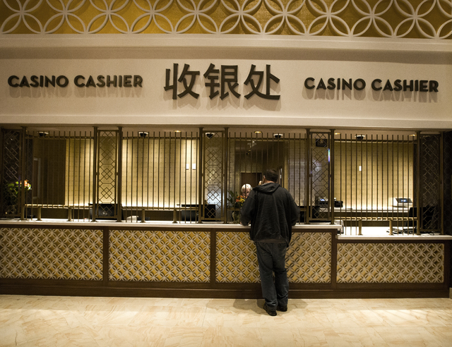 A man stands at the casino cashier in the  Lucky Dragon hotel-casino, 300 W. Sahara Ave., on Friday, Nov. 18, 2016. Las Vegas' newest casino, which will cater to Asians, is schedule to open tomorr ...