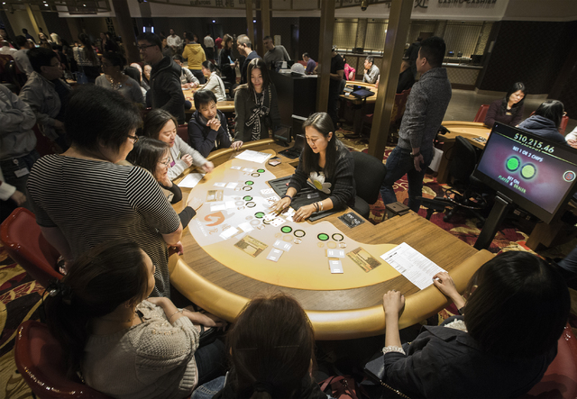 Lina Yang,right, deals EZ pai gow while other staff members watch at  the Lucky Dragon hotel-casino, 300 W. Sahara Ave., on Friday, Nov. 18, 2016. Las Vegas' newest casino, which will cater to Asi ...