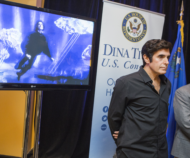 Magician David Copperfield stands while a video of magic is shown during a news conference at The Orleans on Tuesday, Aug. 16, 2016, to promote H.Res 642, a bill to recognize magic as a rare and v ...