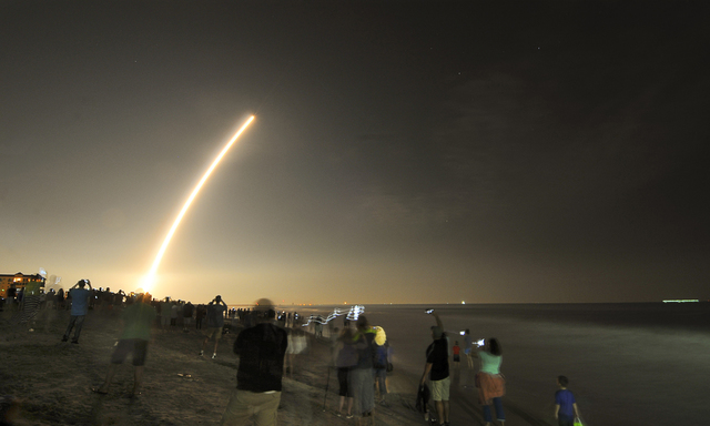 Cell phones light up the beaches of Cape Canaveral and Cocoa Beach, Fla., north of the Cocoa Beach Pier as spectators watch the launch of the NOAA GOES-R weather satellite, Saturday, Nov. 19, 2016 ...