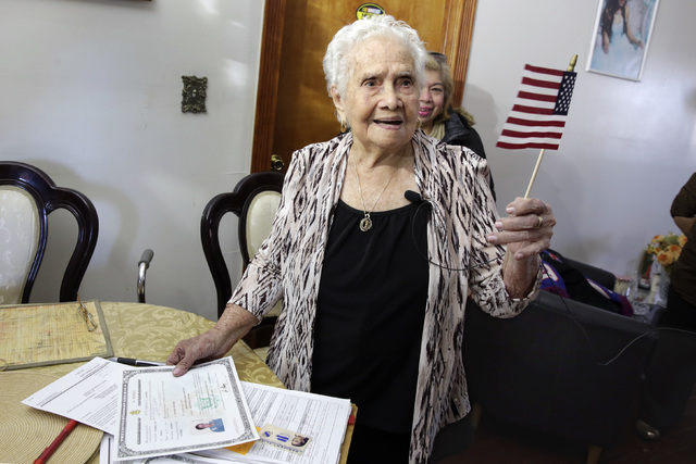 America Maria Hernandez, 99, holds an American flag after being administered the Naturalization Oath of Allegiance, Wednesday, Nov. 23, 2016 photo, in the Queens borough of New York. (Richard Drew/AP)