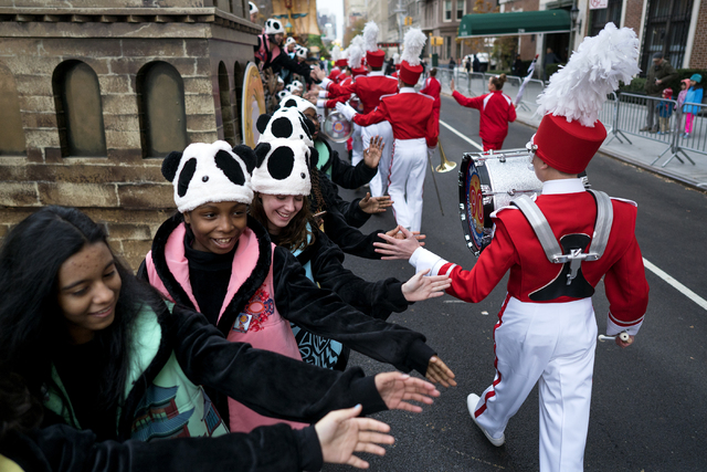Participants greet others as they await the start of the Macy's Thanksgiving Day Parade in New York, Thursday, Nov. 24, 2016. (Craig Ruttle/AP)