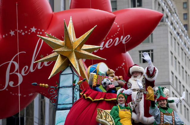 Santa Claus waves to spectators along Central Park West during the Macy's Thanksgiving Day Parade in New York Thursday, Nov. 24, 2016. (Craig Ruttle/AP)
