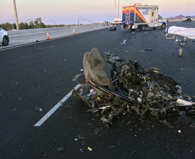 This photo provided by the Arizona Department of Public Safety shows debris from a car that hit a Greyhound bus head-on on Interstate 10 in a Phoenix suburb, Friday, Nov. 25, 2016. (Arizona Depart ...