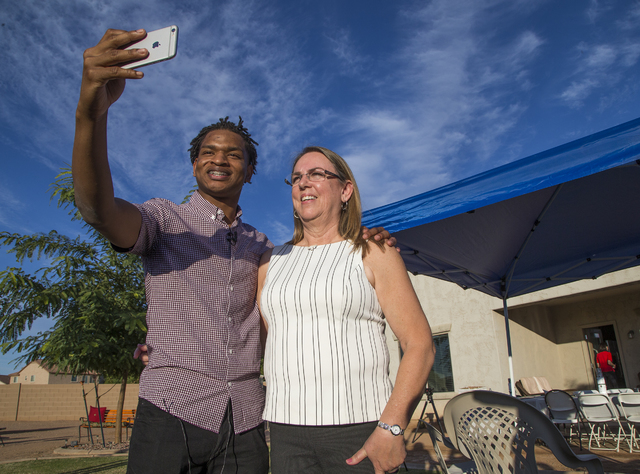 In this Thursday, Nov. 24, 2016 photo, Jamal Hinton and Wanda Dench take a selfie together after meeting at Wanda's home for Thanksgiving dinner, in Mesa, Ariz. (Tom Tingle/The Arizona Republic vi ...