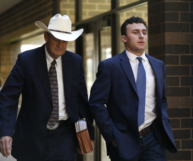 Former Cleveland Browns quarterback Johnny Manziel, right, arrives with his lawyer Jim Darnell, right, for a hearing Thursday, May 5, 2016, Dallas. The Heisman Trophy winner and former Texas A&amp ...