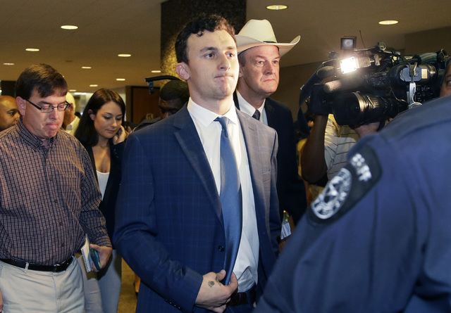 Former Cleveland Browns quarterback Johnny Manziel walks with his lawyer Jim Darnell, right, after a hearing Thursday, May 5, 2016, Dallas. The Heisman Trophy winner and former Texas A&M star  ...