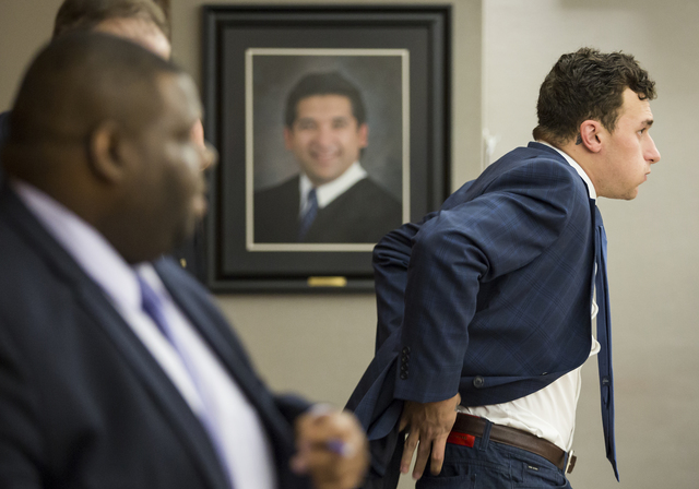 Former Cleveland Browns quarterback Johnny Manziel sits down at the defense table for his initial hearing, Thursday, May 5, 2016, in Dallas. (Smiley N. Pool/The Dallas Morning News via AP, Pool)