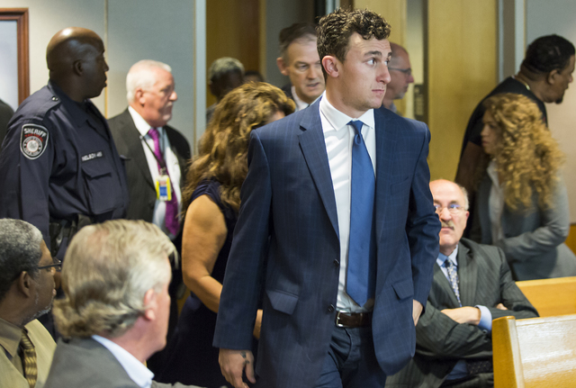 Former Cleveland Browns quarterback Johnny Manziel walks into the courtroom for his initial hearing, Thursday, May 5, 2016, in Dallas. The Heisman Trophy winner and former Texas A&M star was i ...