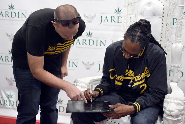 A guest gets an autograph from rapper Snoop Dogg at Jardin cannabis dispensary Friday, Nov. 11, 2016, in Las Vegas. David Becker/Las Vegas Review-Journal Follow @davidjaybecker
