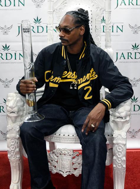 Rapper Snoop Dogg holds a bong he received as a gift during an appearance at Jardin cannabis dispensary Friday, Nov. 11, 2016, in Las Vegas. David Becker/Las Vegas Review-Journal Follow @davidjayb ...