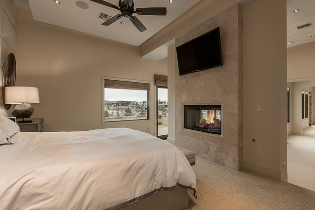 The master bedroom opens to a patio. (Courtesy)
